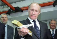 В.В.Путин и слиток золота